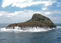 A solitary island in the distant ocean, Sandon Iwa Rocks.